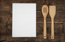 Wooden kitchenware and blank paper sheets for recipes Royalty Free Stock Photos