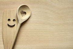 Wooden kitchenware on cutting board Royalty Free Stock Photography