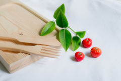 Wooden kitchenware with decoration. Wooden kitchenware with cheery and leaf decoration Royalty Free Stock Photos