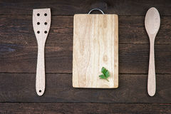 Wooden kitchenware with mint leaf on cutting board Stock Photos
