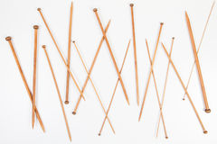 Wooden knitting needles in different sizes on white background Royalty Free Stock Photography