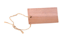 Wooden label. Old styled wooden blank label (tag) with a rope attached isolated on white Stock Photo
