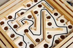 Wooden labyrinth with holes Royalty Free Stock Image