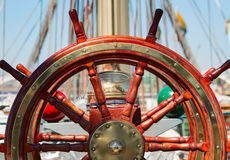Wooden lacquer steering wheel of the sailboat Stock Photography