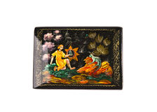 Wooden lacquered casket with painting on lid. Stock Photos