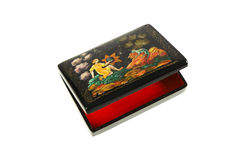 Wooden lacquered casket with a pattern. Black wooden lacquered casket with painting on lid. The theme of painting old russian fairy tales. Cover slightly open Royalty Free Stock Photos