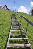 Wooden ladder. The wooden ladder is made on the mountain Stock Photo