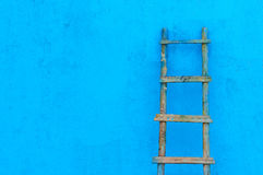Wooden  ladder. The  wooden  ladder  on  blue  wall Stock Photos