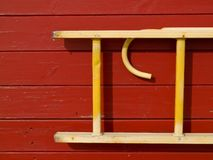 Wooden ladder hanged on a wall Royalty Free Stock Image
