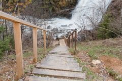 Wooden ladder to waterfall. A ladder to the river. Stock Photos