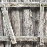 Wooden ladder on the wall Stock Images