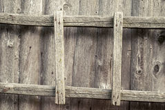 Wooden ladder on the wall Stock Photo