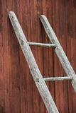 Wooden ladder and wall of old farmhouse Royalty Free Stock Images