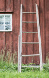 Wooden ladder and wall of old farmhouse Royalty Free Stock Photos