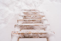 Wooden ladder in the winter Stock Photos