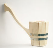 Wooden ladle for the sauna on a white Stock Images