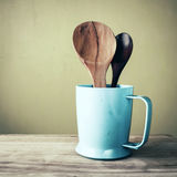 Wooden ladles in plastic glass, vintage stlye Royalty Free Stock Photography