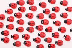 Wooden ladybugs stock photography