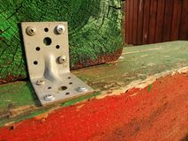 Wooden lags fasten together painted green and red building elements royalty free stock photography