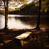 Wooden Lake Bench. In Fairfield, CT Stock Photo