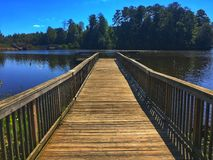 Lake dock. Wooden lake dock with blue sky Royalty Free Stock Photos