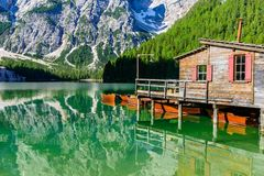 Wooden lake house at Lake Braies also known as Pragser Wildsee  in beautiful mountain scenery. Amazing Travel destination Lago di royalty free stock image