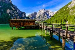 Wooden lake house at Lake Braies also known as Pragser Wildsee  in beautiful mountain scenery. Amazing Travel destination Lago di stock photos