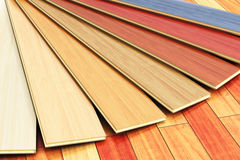 Wooden laminated construction planks assortment on parquet floor Stock Photography