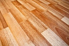 Wooden laminated floor. Close up detail of a beautiful wooden brown laminated floor royalty free stock photo