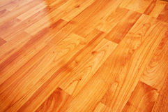 Wooden laminated floor. Close up detail of a beautiful wooden brown laminated floor stock photo
