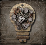 Wooden lamp with cogs and gears. Idea and invention concept. Stock Photos