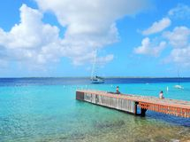 Wooden landing stage on Bonaire in the Caribbean Royalty Free Stock Images