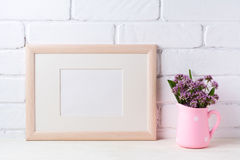 Wooden landscape frame mockup with purple flowers in pink rustic Royalty Free Stock Photos
