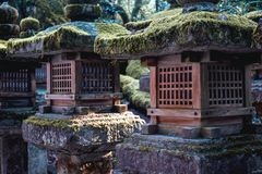 Wooden lanterns covered by moss in Nara Japan royalty free stock images