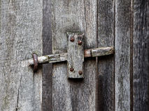 The wooden latch on a wooden door Royalty Free Stock Photo