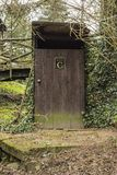 Wooden latrine. In the forrest stock photo
