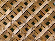 Wooden Lattice. A wooden lattice background in the late day sun Royalty Free Stock Images