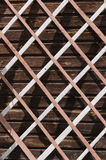 The wooden lattice. Against the wall of a country house Stock Photos