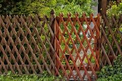 Wooden lattice grid. Fence. Garden entrance royalty free stock photo