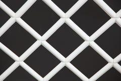 Wooden lattice. Pattern in white stock image