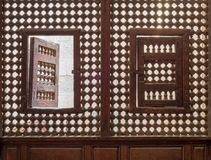 Wooden latticed window Mashrabiya with two small swinging sashes royalty free stock photos