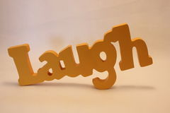 Wooden laugh sign Royalty Free Stock Images