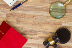 Wooden Law Gavel. With legal book, looking glass and pc keyboard Royalty Free Stock Images