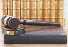 Wooden Law Gavel. And a row of law books Stock Image