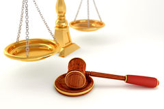 Wooden Law Gavel with Scale Royalty Free Stock Photography
