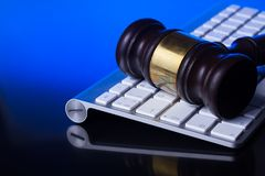 Workspace hero header with law gavel. Wooden law gawel on computer keyboard, internet auction concept Stock Photos