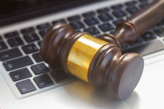 Wooden law gawel. On laptop keyboard close up, judgement concept Royalty Free Stock Photos