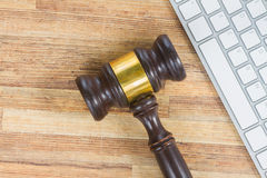 Wooden law gawel. On wooden table with keyboard, judgement concept Stock Image