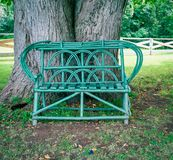 Wooden lawn bench stock photo
