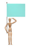 The wooden lay figure with a flag stands at attention and salutes. Stock Photos